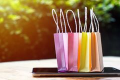 Online shopping, E-commerce, fast and easy trading concept : Col. Orful mini shopping bag, Paper bag on tablet depicts customers order things from retailer sites royalty free stock image