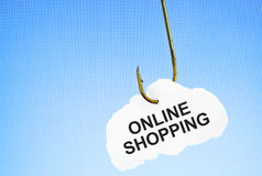 Hooked on Online Shopping. Online Shopping on a fishing hook infront of blue computer monitor. Conceptual image about the risk of addiction to online shopping Stock Photo