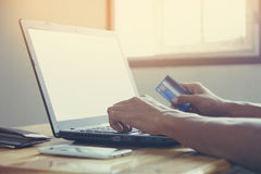Online shopping. Hands holding credit card and using laptop. Online shopping Royalty Free Stock Photos