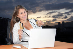 Online shopping Happy woman in the office using your credit card Royalty Free Stock Images