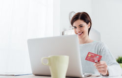 Online shopping at home Stock Image