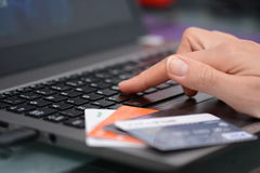 Online shopping and internet banking concepts suggested by a woman using technology and credit cards Royalty Free Stock Images