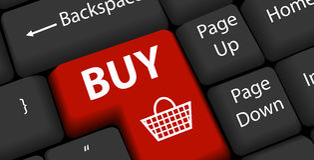 Online shopping on keyboard Enter Stock Photo