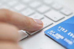 Online shopping. Man is entering credit card information to web site to complete shopping Stock Photo