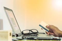 Online shopping. Man using credit card for online shopping royalty free stock images