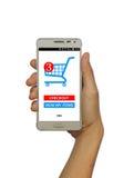 Online-shopping med den smarta telefonen på isolerad vit bakgrund Royaltyfri Foto