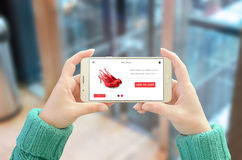 Online shopping with mobile phone. Modern user interface on horizontal device screen. Woman holding and show phone. Glass of business center in background Royalty Free Stock Photo