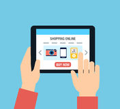 Online Shopping. A person using a tablet for online shopping Royalty Free Stock Photography