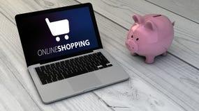 Online shopping and piggybank Royalty Free Stock Photos