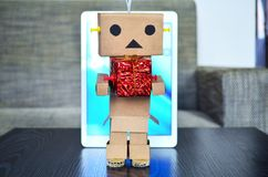 Online shopping, robot delivery christmas present stock photo