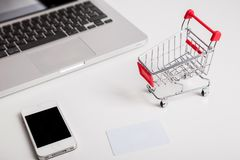 Online shopping. Shopping cart, keyboard, bank card stock image