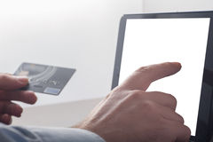 Online shopping with tablet device stock photos