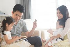 Asian family online shopping stock photography
