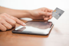 Online shopping using a digital tablet royalty free stock images