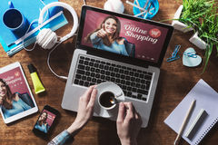 Online shopping. Website on laptop screen with female hands holding a coffee Royalty Free Stock Photo