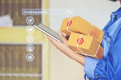 Online shopping, Woman hand holding smart phone and tracking parcel online to update status with hologram, Ecommerce and delivery. Service status tracking stock image