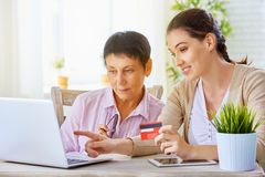 Online shopping. A women doing online shopping royalty free stock image