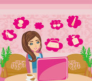 Online shopping - young smiling woman sitting with laptop Royalty Free Stock Image