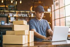 Online shopping young start small business in a cardboard box at. Work. The seller prepares the delivery box for the customer, online sales, or ecommerce royalty free stock photography