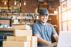 Online shopping young start small business in a cardboard box at. Work. The seller prepares the delivery box for the customer, online sales, or ecommerce stock photos