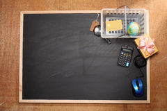 Online shoppping concept. Shopping tools on top of blackboard Stock Images