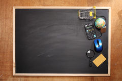 Online shoppping concept. Shopping tools on top of blackboard Stock Image
