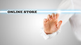Online store on a virtual screen. Contained in a narrow navigation bar with a man activating it from behind Royalty Free Stock Photo
