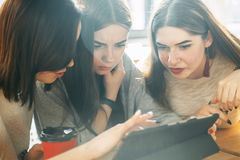 Students work at common project using tablet pc Royalty Free Stock Photography