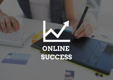 Online success text against hands with graphics tablet Stock Image