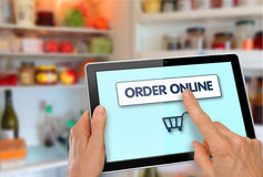 Online Supermarket Shopping Tablet with Hands Royalty Free Stock Photos