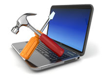 Online support. Laptop with screwdriver and hammer. Stock Photos