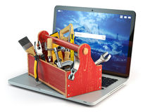 Online support. Laptop and toolbox with tool  isolated on white Royalty Free Stock Photography