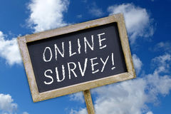Online Survey - chalkboard with text. Some clouds and blue sky in the background stock photos