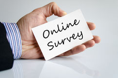 Online Survey concept. Business man hand writing online survey stock photo