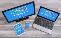 Online survey concept on different devices. Online survey concept shown on different information technology devices stock photography