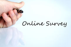 Online Survey concept. Pen in the hand over white background Online Survey concept royalty free stock photography