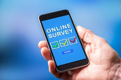 Online survey concept on a smartphone. Smartphone screen displaying an online survey concept royalty free stock image
