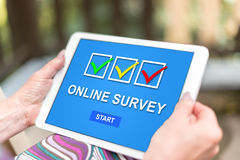 Online survey concept on a tablet. Female hands holding a tablet with online survey concept royalty free stock image