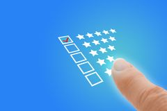 Online Survey with Finger Pointing at Excellent Tick. Online survey questionnaire concept stock photography