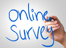 Online survey hand writing with a blue mark on a transparent board.  royalty free stock photos