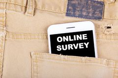 Online Survey. Smartphone in jeans pocket. Technology business and Review, Feedback Concept background Royalty Free Stock Photography