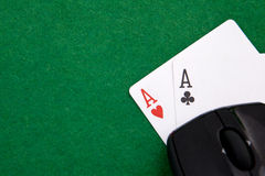 Online Texas holdem pocket aces on casino table. With copy space Royalty Free Stock Photography