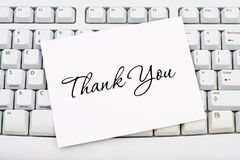 Online Thank You. A thank you card sitting on a computer keyboard, online thank you royalty free stock image