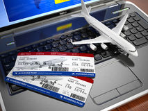 Online ticket booking. Airplane and boarding pass on laptop keyb Stock Photo