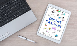 Online training concept on a digital tablet. Online training concept shown on a digital tablet Royalty Free Stock Photography