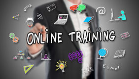 Online training concept drawn by a businessman. In background Royalty Free Stock Image