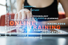 Online training on the virtual screen. Education concept. Words cloud. Stock Photos
