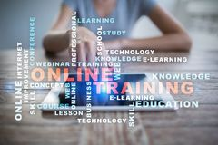 Online training on the virtual screen. Education concept. Words cloud. Stock Photo