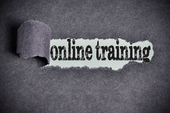 Online training word under torn black sugar paper Stock Photos