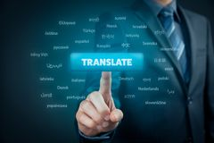 Online translator. And language e-learning course concept. Computer user press button with text translate and most important world languages royalty free stock photos